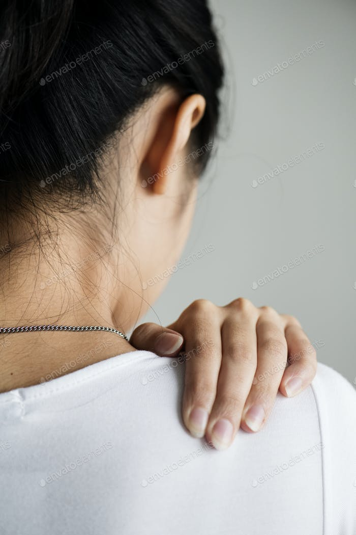 Asian woman suffering back pain