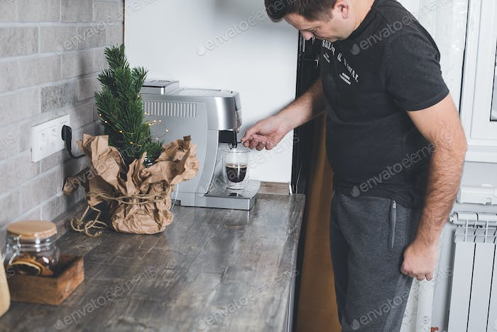 Coffee preparation concept at home. man preparing morning coffee. Lifestyle, domestic life concept