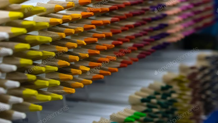 The colorful pencil on the shelf