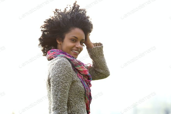 Attractive young african american woman with hand in hair