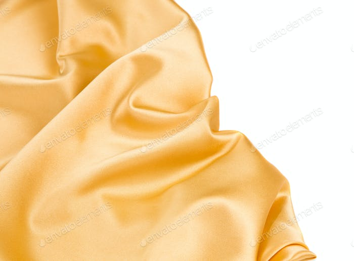 Closeup of yellow silk cloth texture.