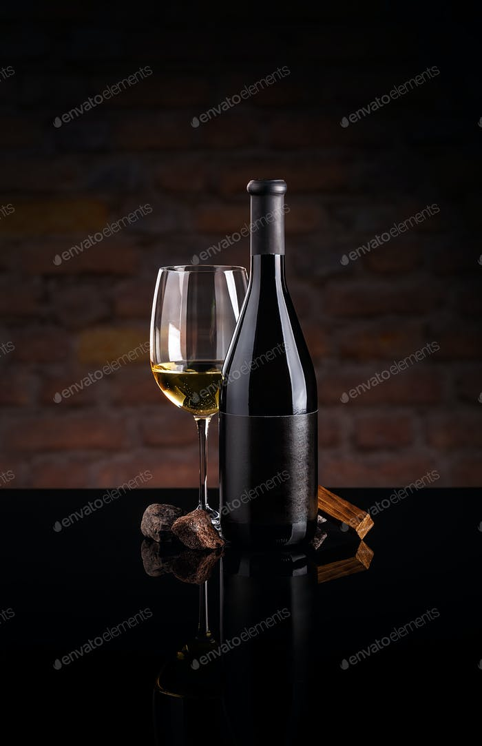 Glass of wine and wine bottle.