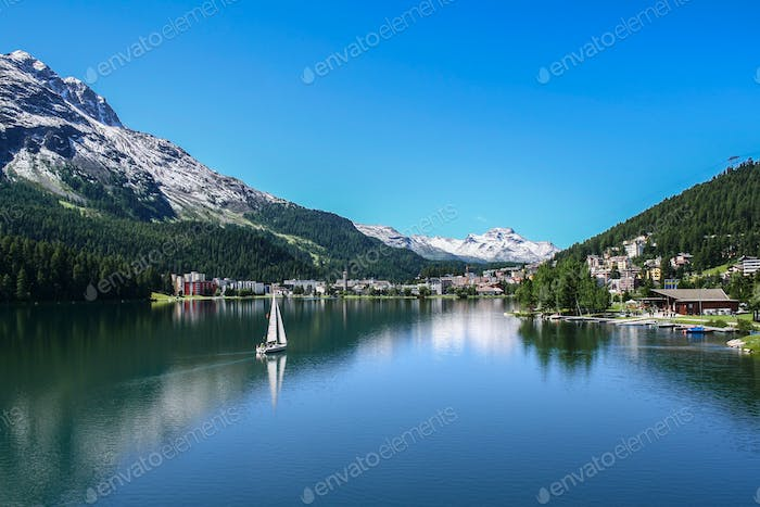View of Saint Moritz lake with small boat