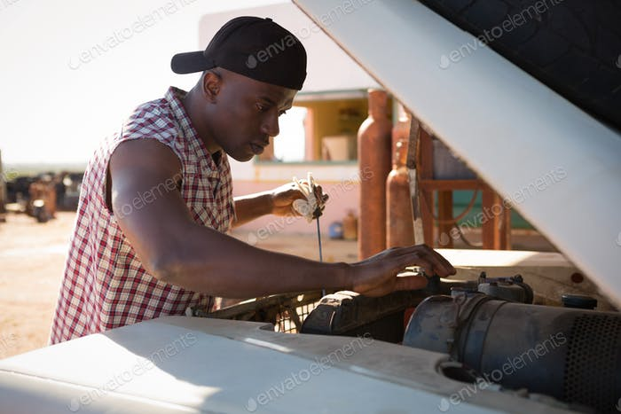 Man repairing a car