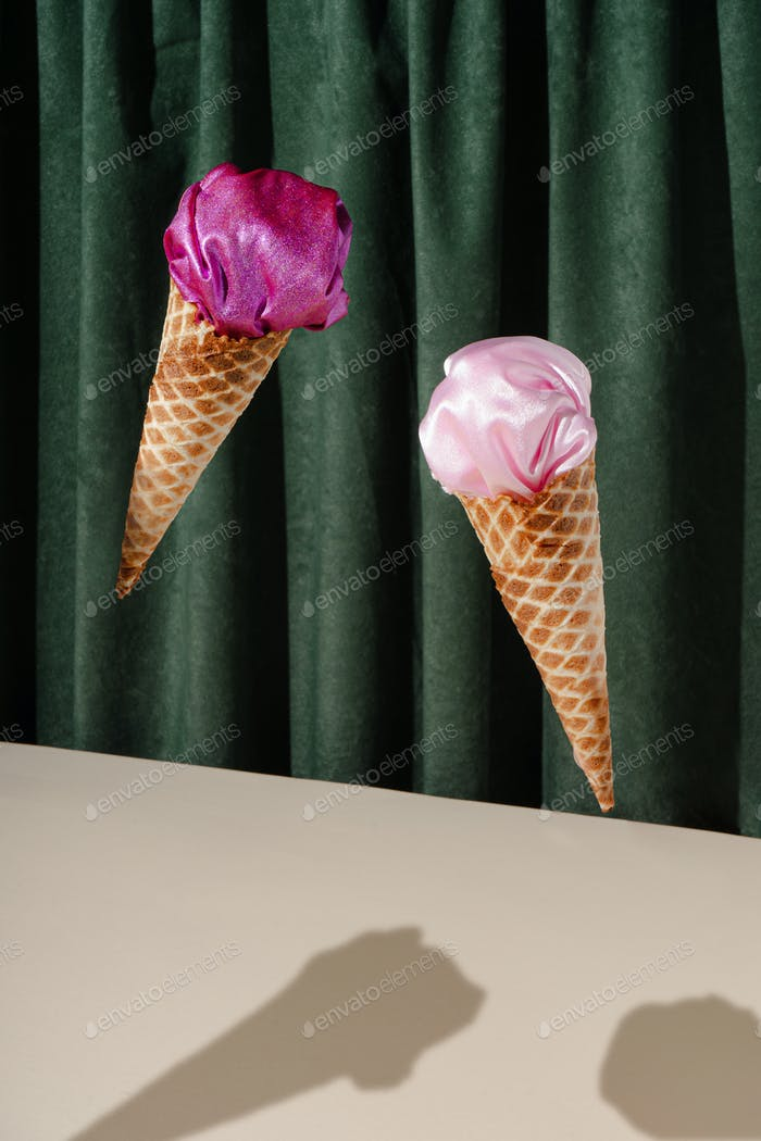 Vintage style concept with ice cream cones and pink fabric.