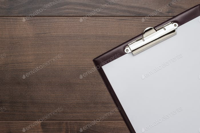 Brown Wooden Office Table With Notepad