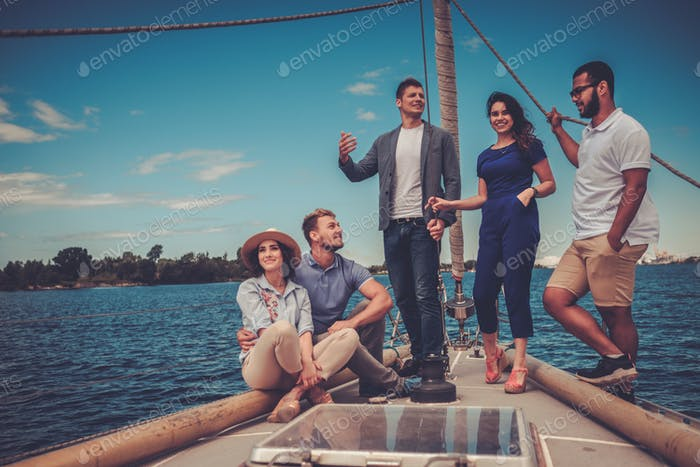 Happy friends resting on a yacht