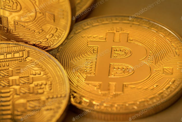 Top view closeup photo of many gold bitcoins