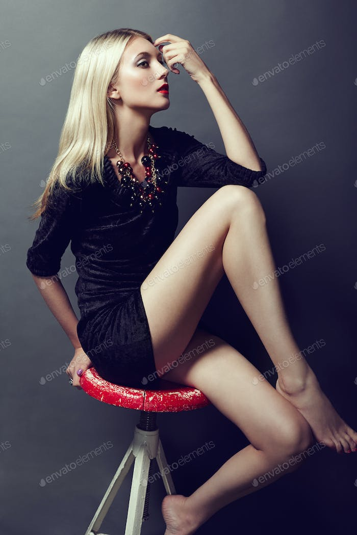Photo of beautiful blonde woman in black dress