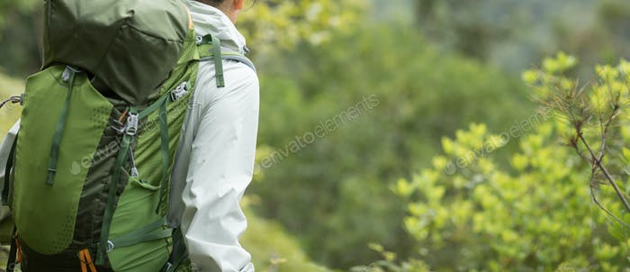HikingWoman hiker enjoy the view in spring