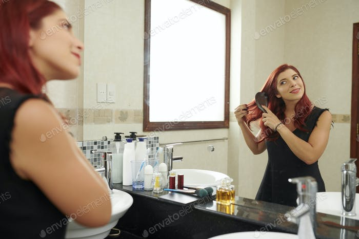 Woman brushing hair