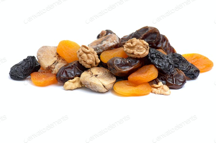 Walnuts and dried fruits collection on white.