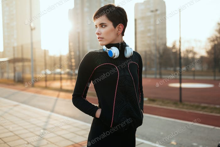 Fit beautiful sporty woman outdoor before fitness exercising