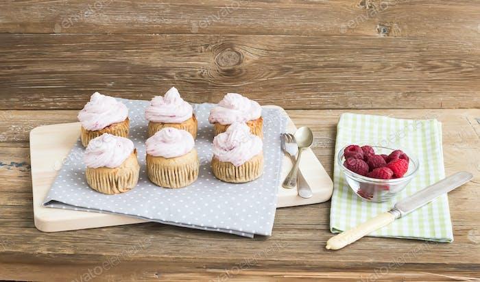 Whole garin cupcakes with cheese cream and fresh raspberries