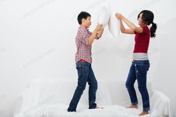 Fighting with pillows