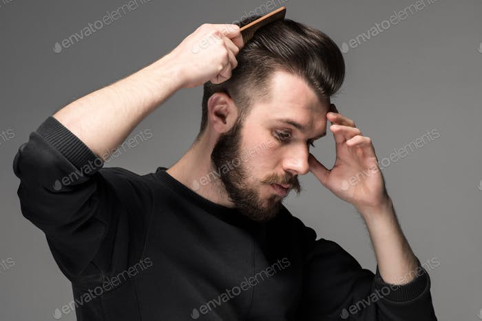 young man comb his hair