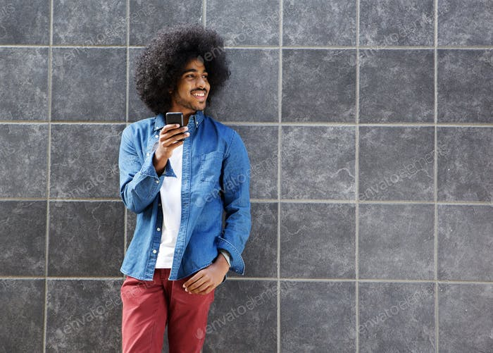 Cool guy with afro using cellphone