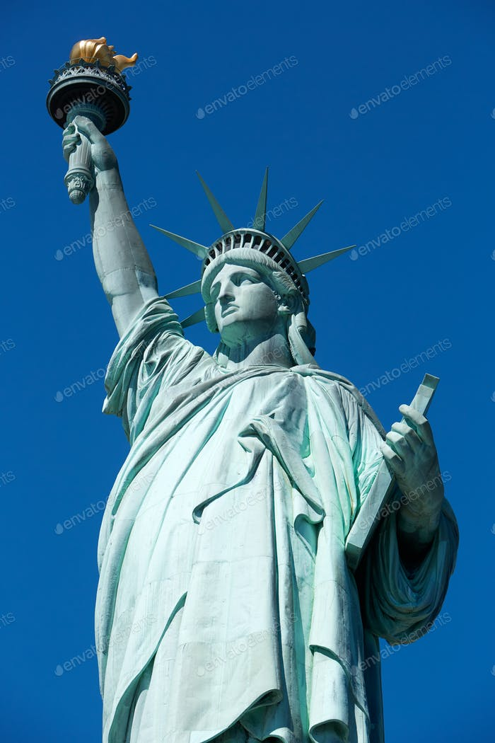 Statue of Liberty, clear blue sky in a sunny day in New York
