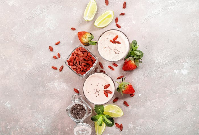 Healthy blended drink. Organic vegan non dairy smoothie with strawberry and goji berrie