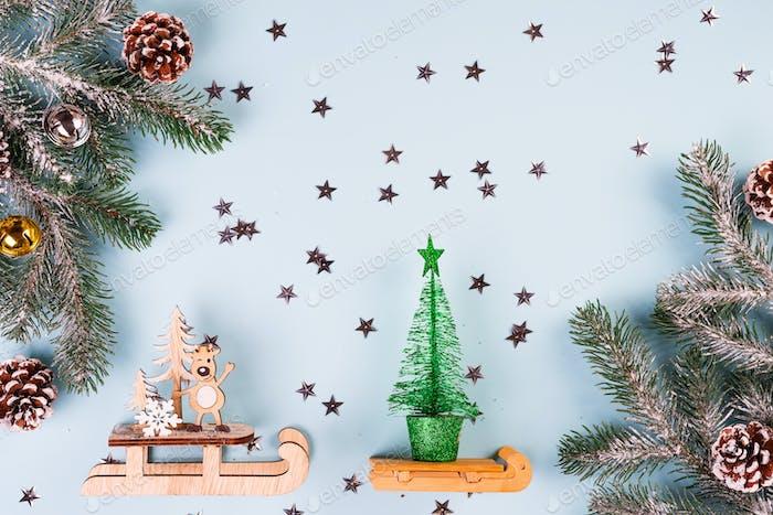 Christmas frame-postcard from decorative Christmas toys, fir, cones, balls, golden stars, deer