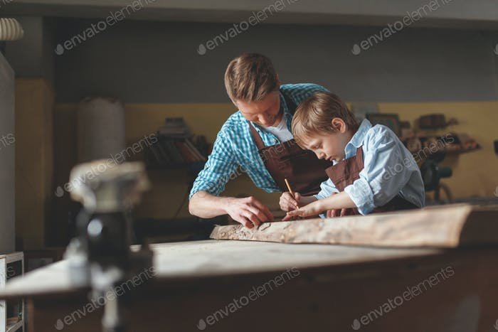 Father and son in the carpentry