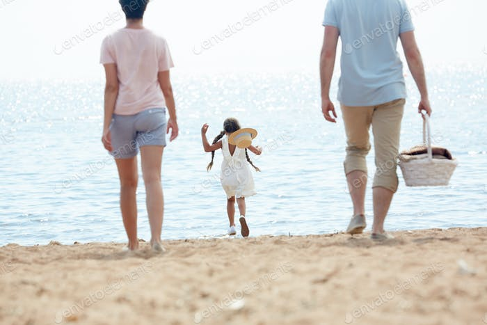Family Arriving to Beach