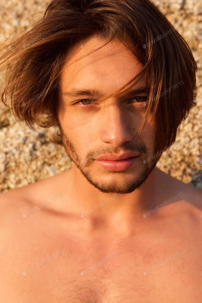 Shirtless male fashion model with beard