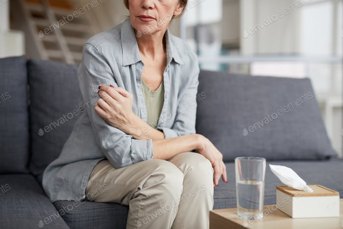 Depressed Mature Woman in Therapist Office
