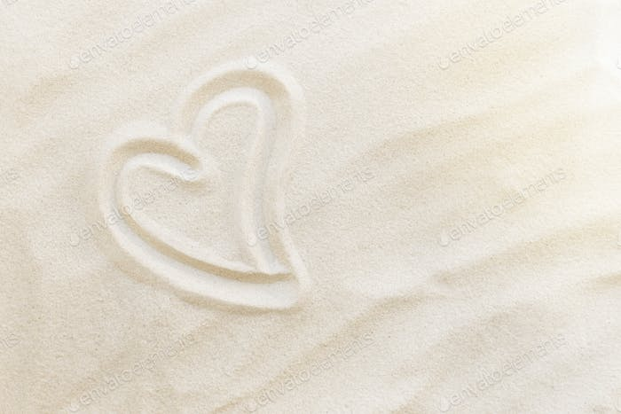 Travel, vacation, honey moon concept. Heart shapes on the sand. Love for two