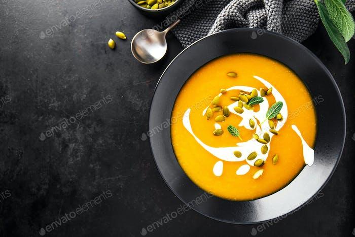 Pumpkin creamy soup served in bowls