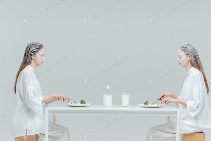 Two beautiful fashion women having lunch
