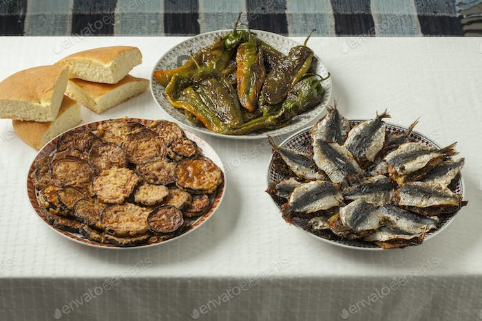 Moroccan meal with stuffed sardines and vegetables