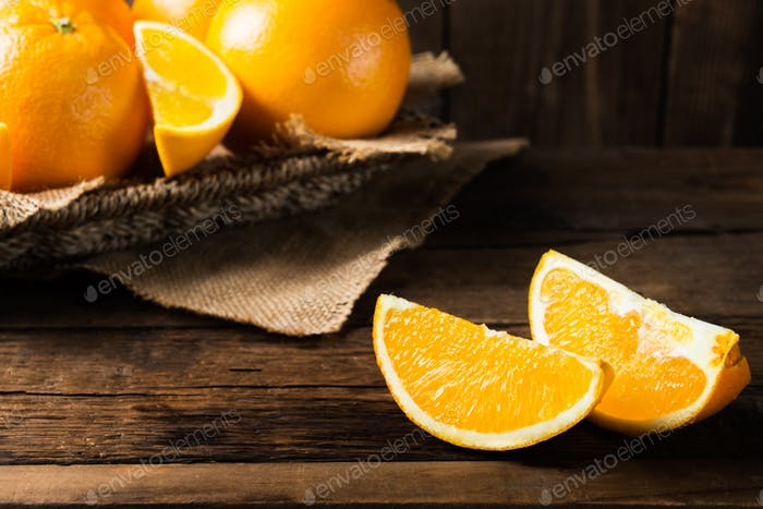 Fresh ripe oranges and slices of oranges
