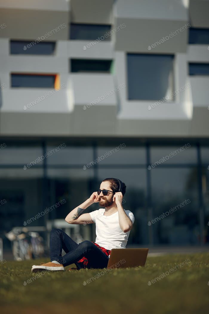 Stylish businessman working in a city