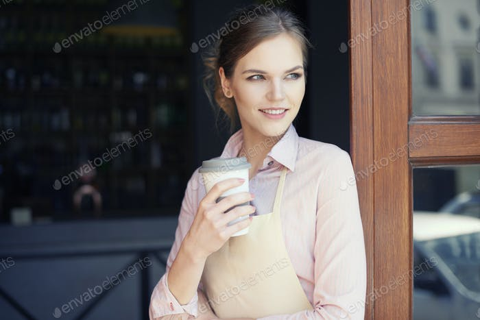 Waist up of waitress with coffee