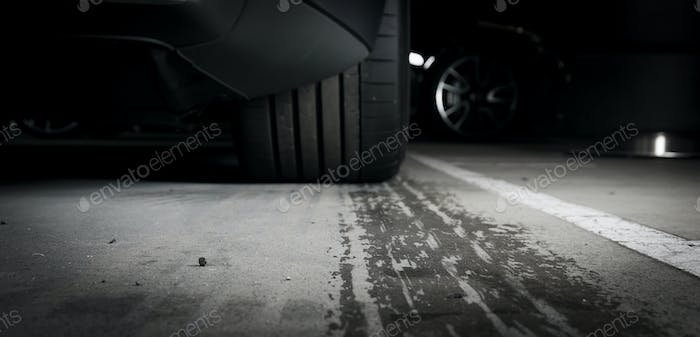Wet tire prints on the asphalt