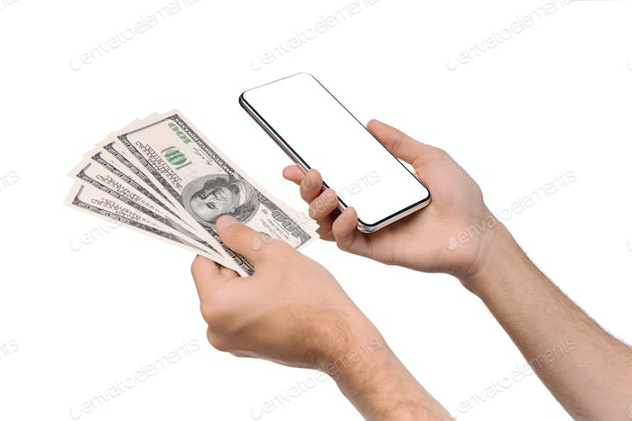 Man holding smartphone with blank screen and bunch of dollars