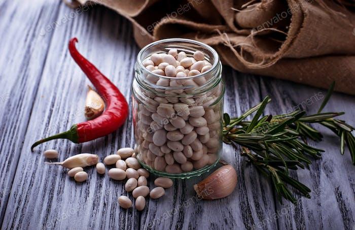 White dry beans in jar.