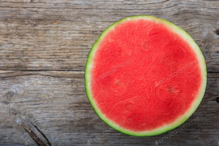 Seedless watermelon on a wooden table - top view