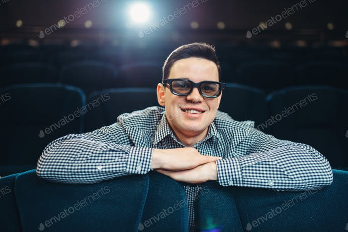 Man in 3d glasses watching the film in cinema
