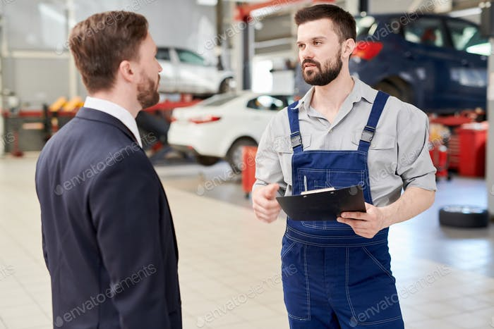 Modern Mechanic Talking to Client