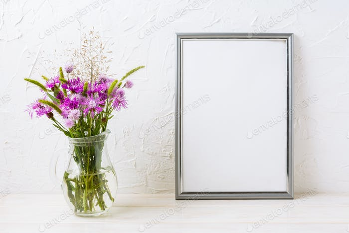 Silver frame mockup with purple burdocks in jug