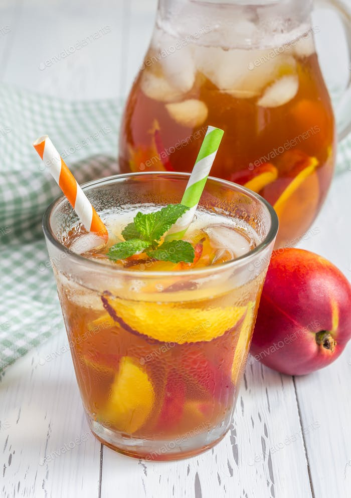 Glass of refreshing homemade nectarine iced tea