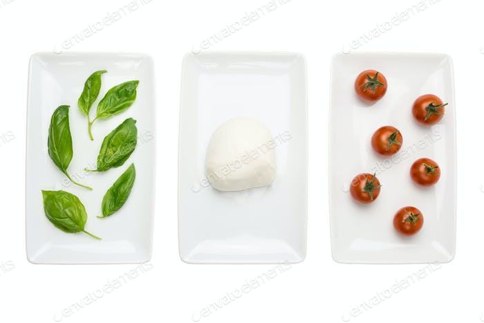 Italian food like flag, basil mozzarella tomato on white