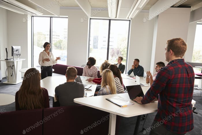 Group Of University Students Attending Lecture On Campus