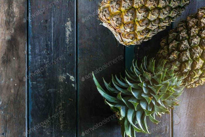 Fresh pineapple on wood.