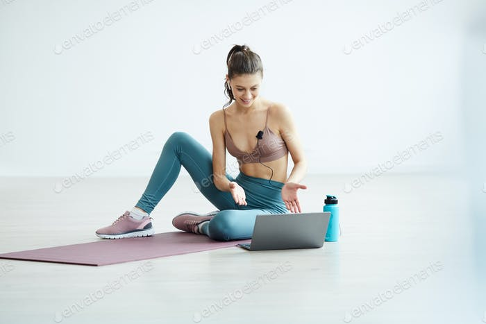 Young Woman Coaching Online Workout