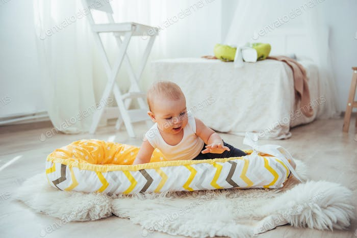Bedding for children. The baby sleeps in bed. A healthy little baby soon after birth.