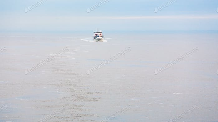 boat with pilot in Baltic sea in morning mist