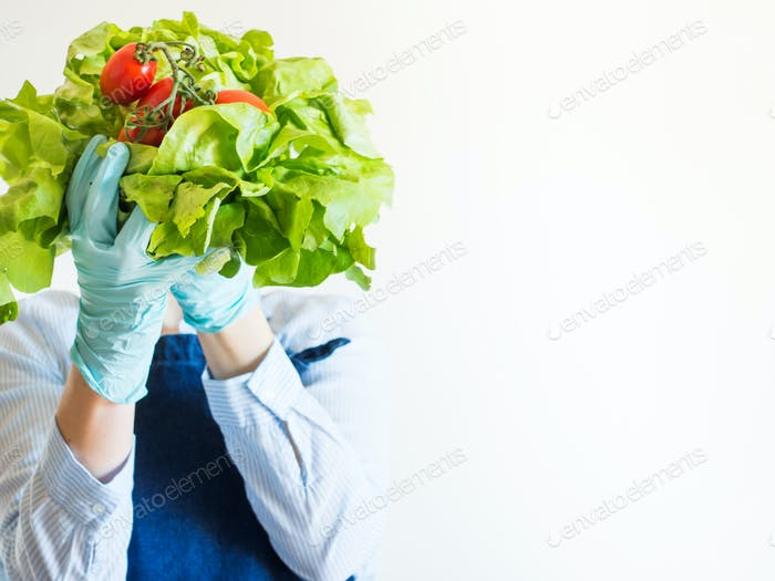 Woman in blue in face mask with fresh produce
